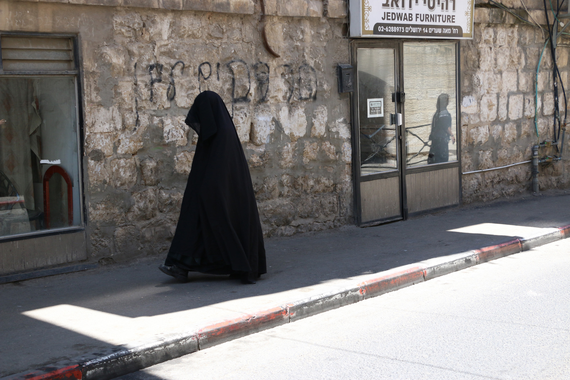 JERUSALEM, ISRAEL, MAY 30, 2016.  A Haredi woman in a burqa-style covering on the streets of Mea Shearim, an ultra-orthodox community in Jerusalem, Israel. 05/30/2016. Photo by Donna M. Airoldi