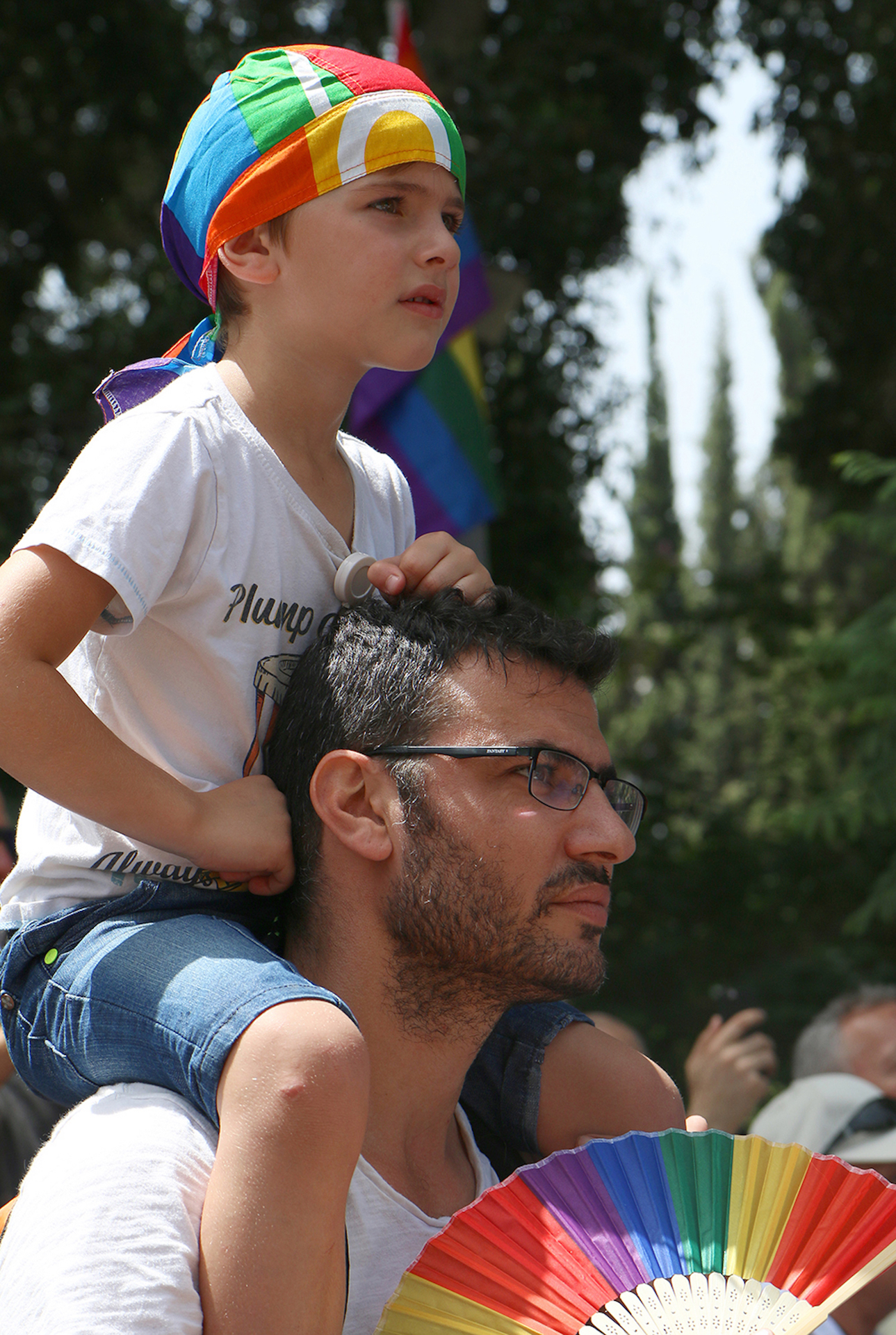 Father and son listening to the concert that marked the beginning of the 2016 Gay Pride Parade in Tel Aviv. Monica Espitia/CUNY J