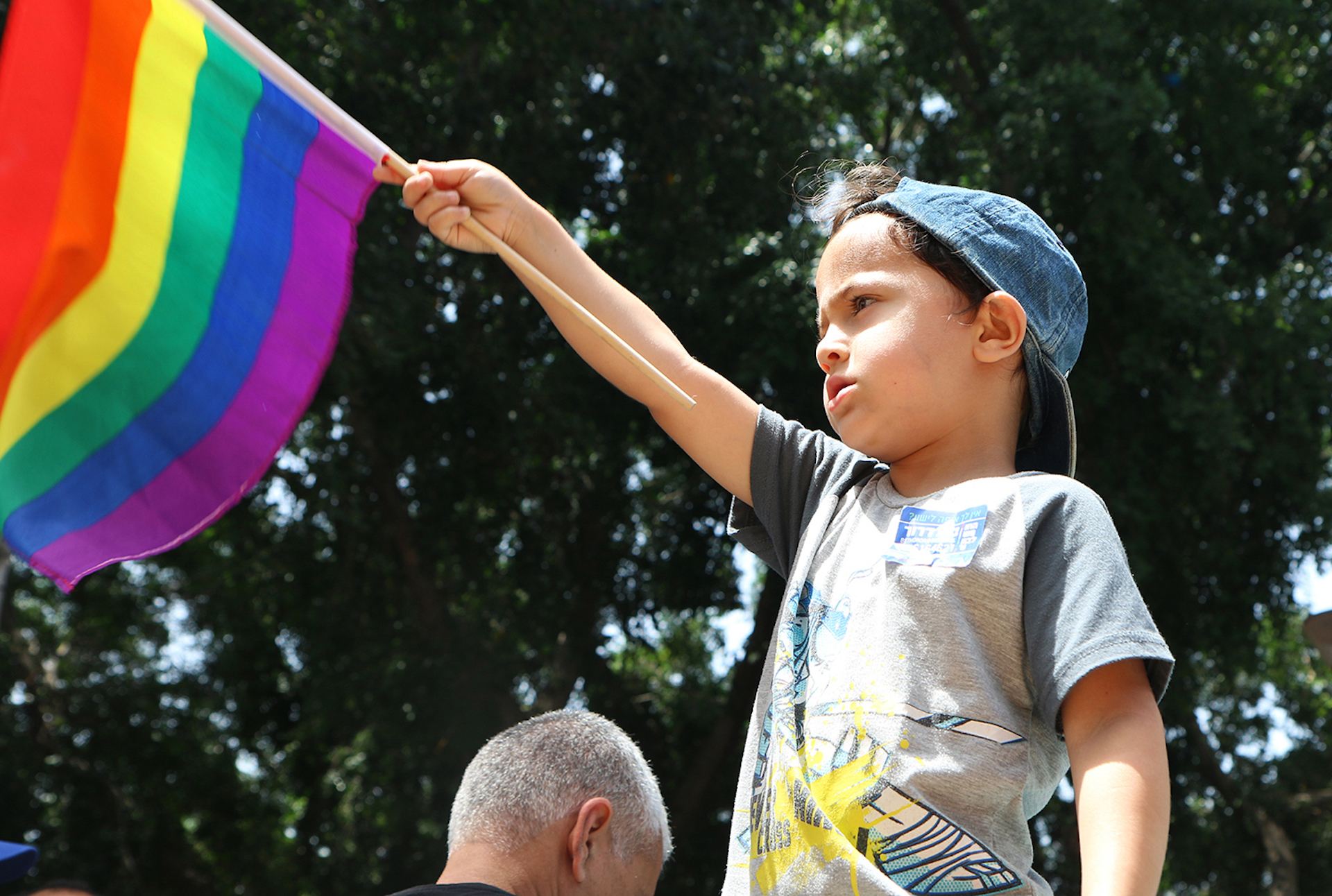 Young participant waving a rainbow flag during the concert that marked the beginning of the 2016 Gay Pride Parade in Tel Aviv. Monica Espitia/CUNY J