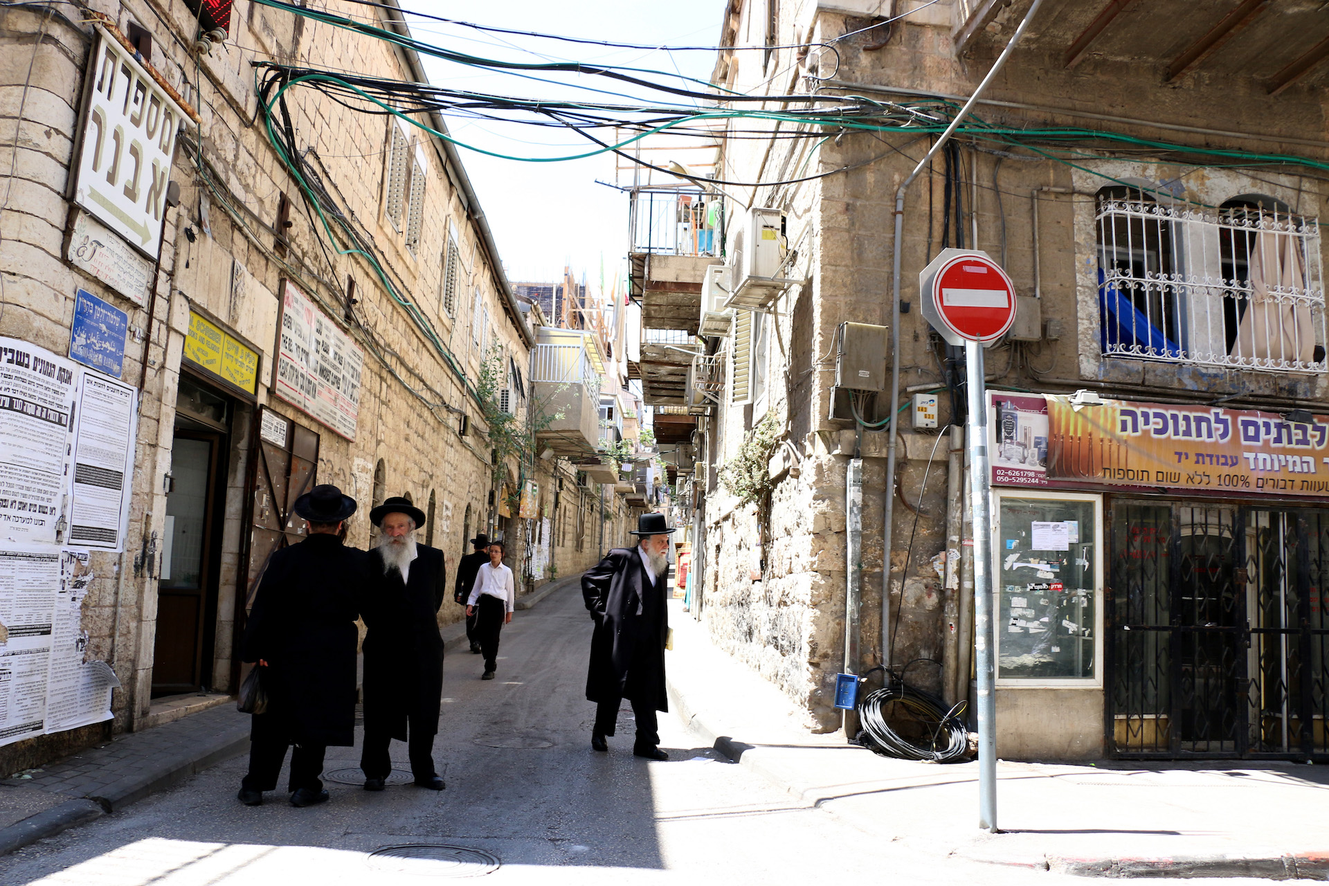 JERUSALEM, ISRAEL, MAY 30, 2016. Men walking down the street in the ultra-Orthodox neighborhood of Mea Shearim in Jerusalem. 05/30/2016. Photo by Donna M. Airoldi