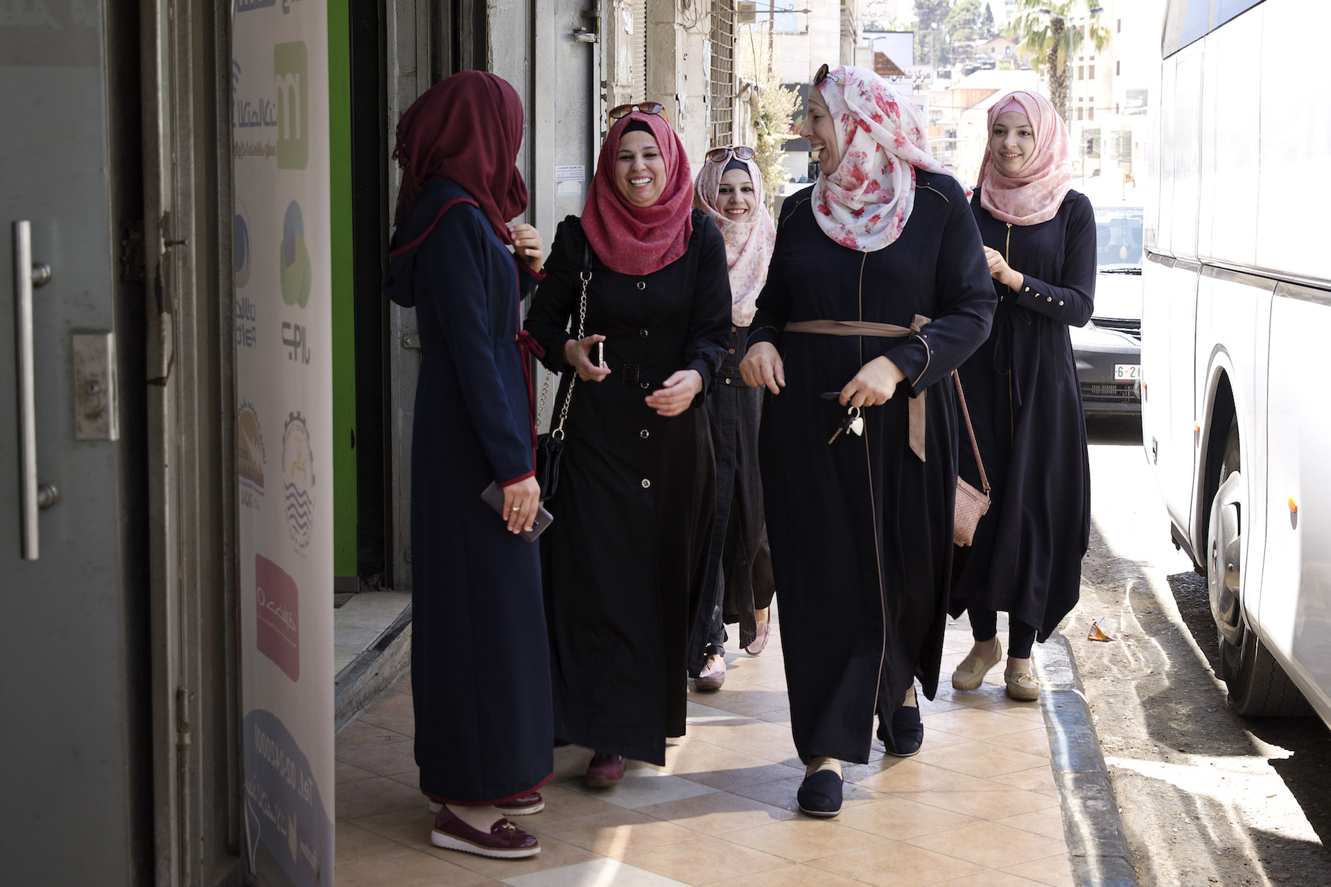 May 31st 2016 Ramallah, West Bank A group of women laugh as they walk on the streets of Ramallah. 05/31/2016 Photo by Christina Thornell