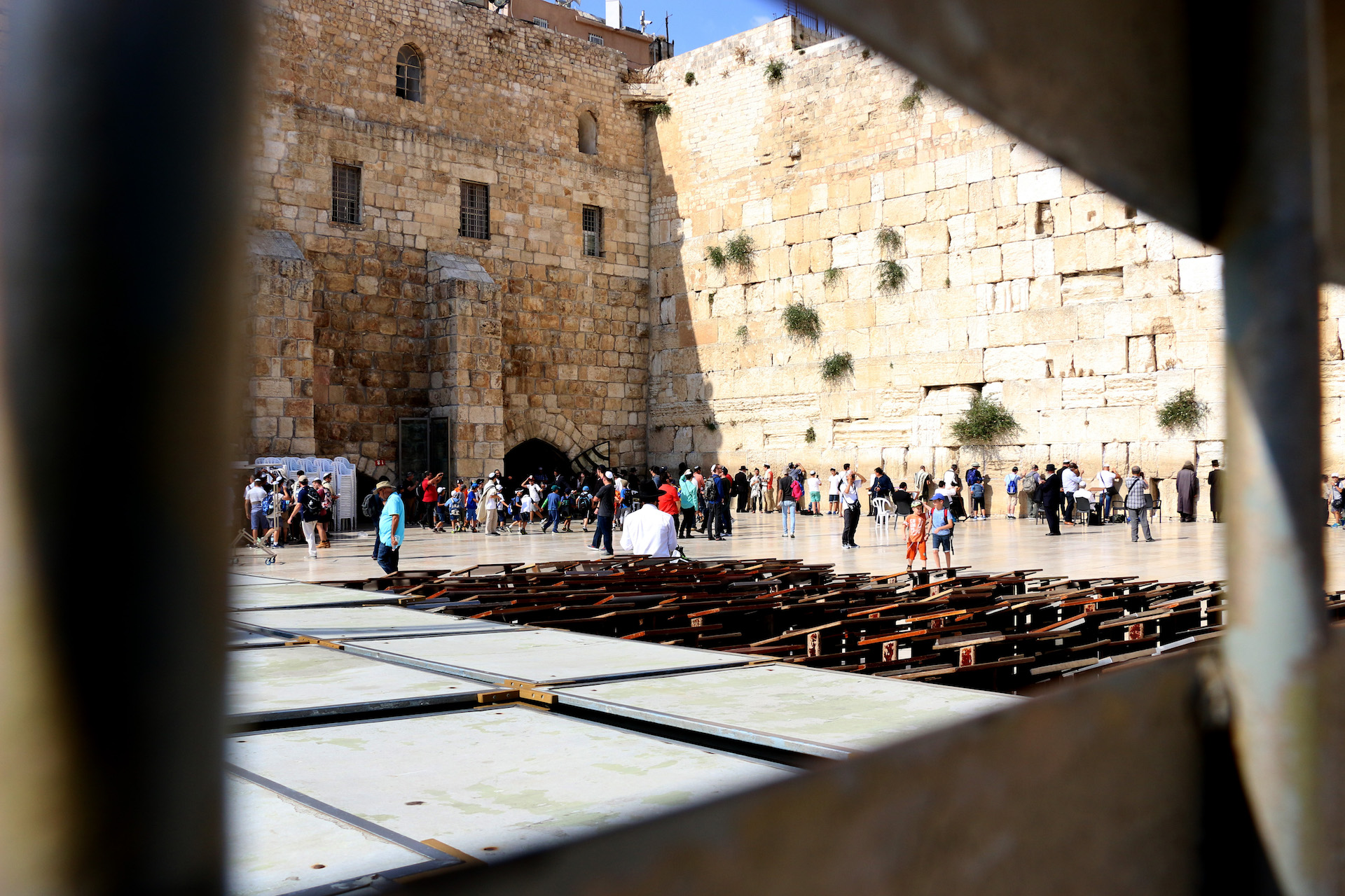 JERUSALEM, ISRAEL, MAY 29, 2016. View of the men at the Western Wall through the fence separating the women's side. Located in Jerusalem's Old City, East Jerusalem. 05/29/2016. Photo by Donna M. Airoldi