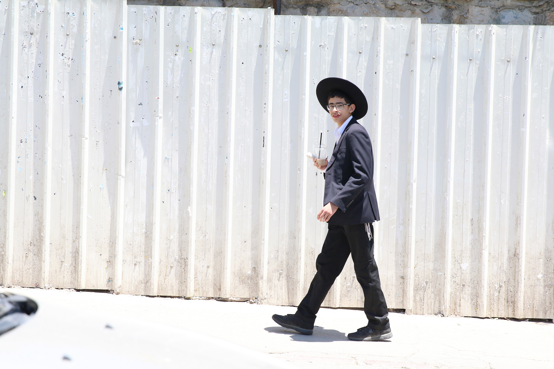 05/30/2016 Jerusalem, Israel A young Haredi boy walks around the Mea Sharim neighborhood in Jerusalem. Mea Sharim is populated mostly by Haredi Jews, a strictly orthodox group inclined to reject modern secular strains of juadaism in favor of traditional practices.