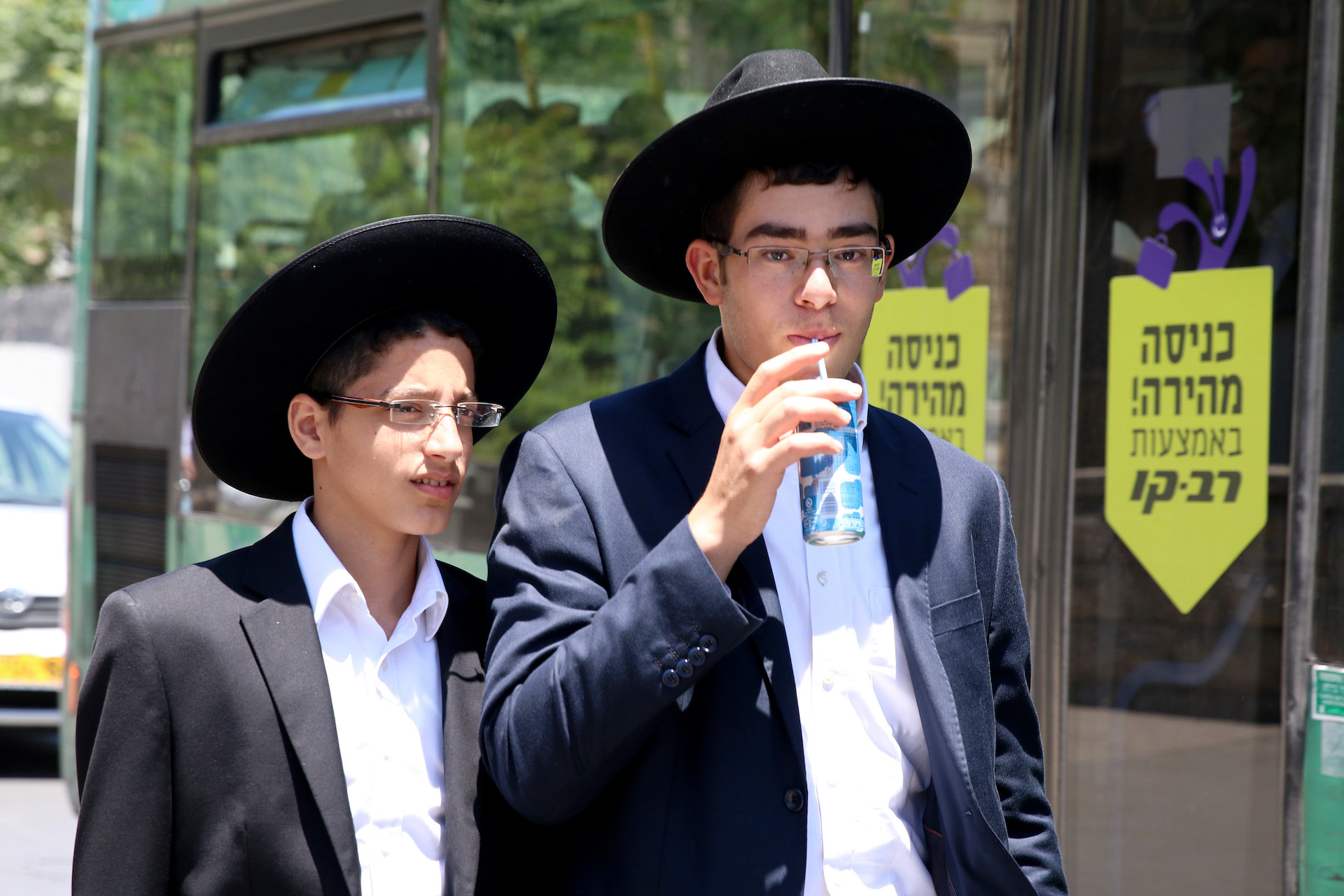 05/30/2016 Jerusalem, Israel Two young Haredi boys walk around the Mea Sharim neighborhood in Jerusalem. Mea Sharim is populated mostly by Haredi Jews, a strictly orthodox group inclined to reject modern secular strains of juadaism in favor of traditional practices.