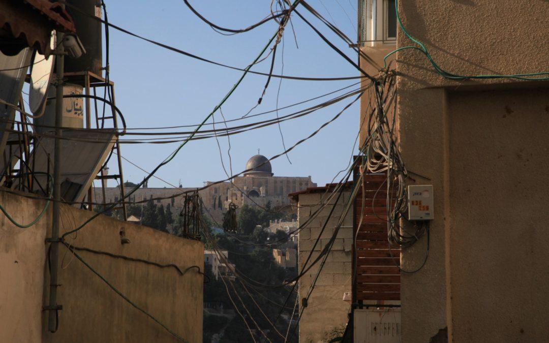 On East Jerusalem streets, Palestinians say settlements trump social media as source of violence