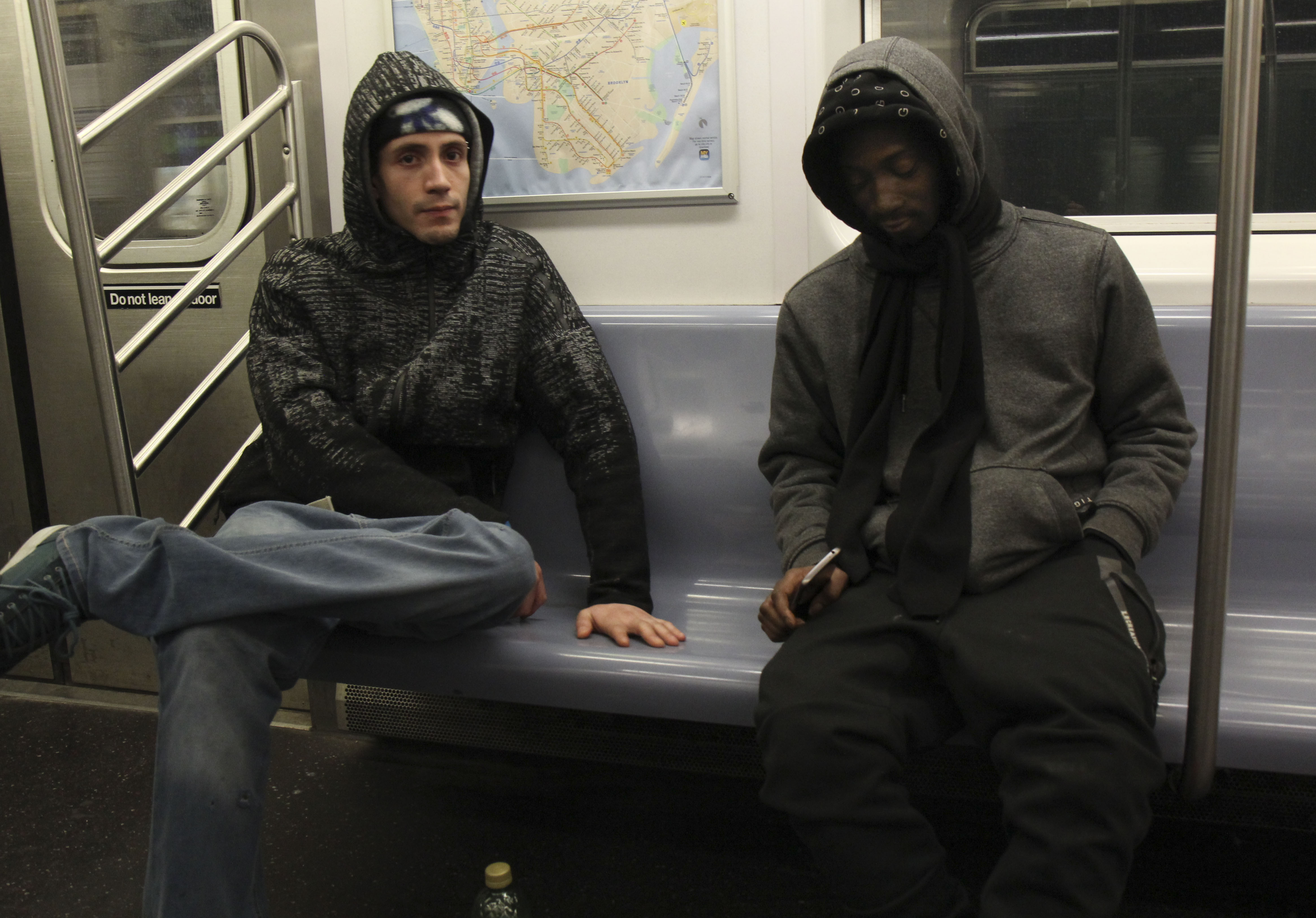 Kevin and a friend ride the train after smoking together.