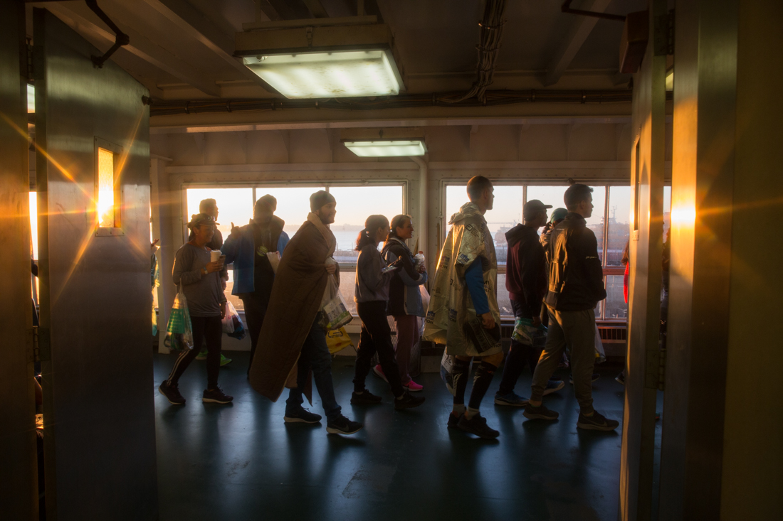 Runners take in the sunrise on the Staten Island Ferry. (Samantha Shanahan/NYCity News Service)
