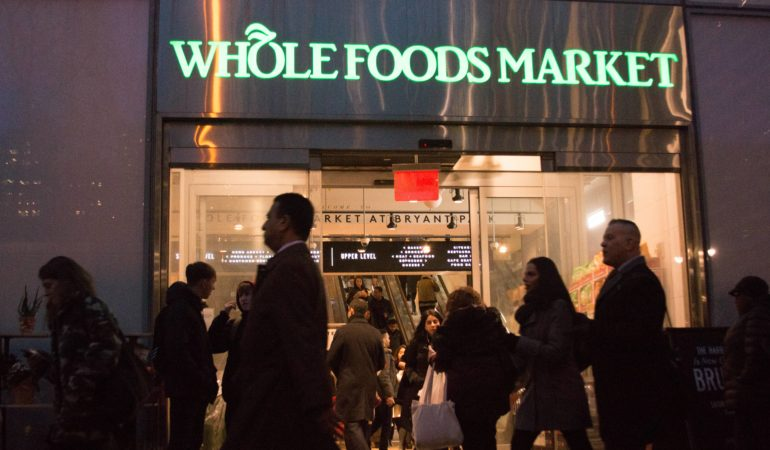 Shoppers exit a Whole Foods in midtown New York on Wednesday, February 14.
