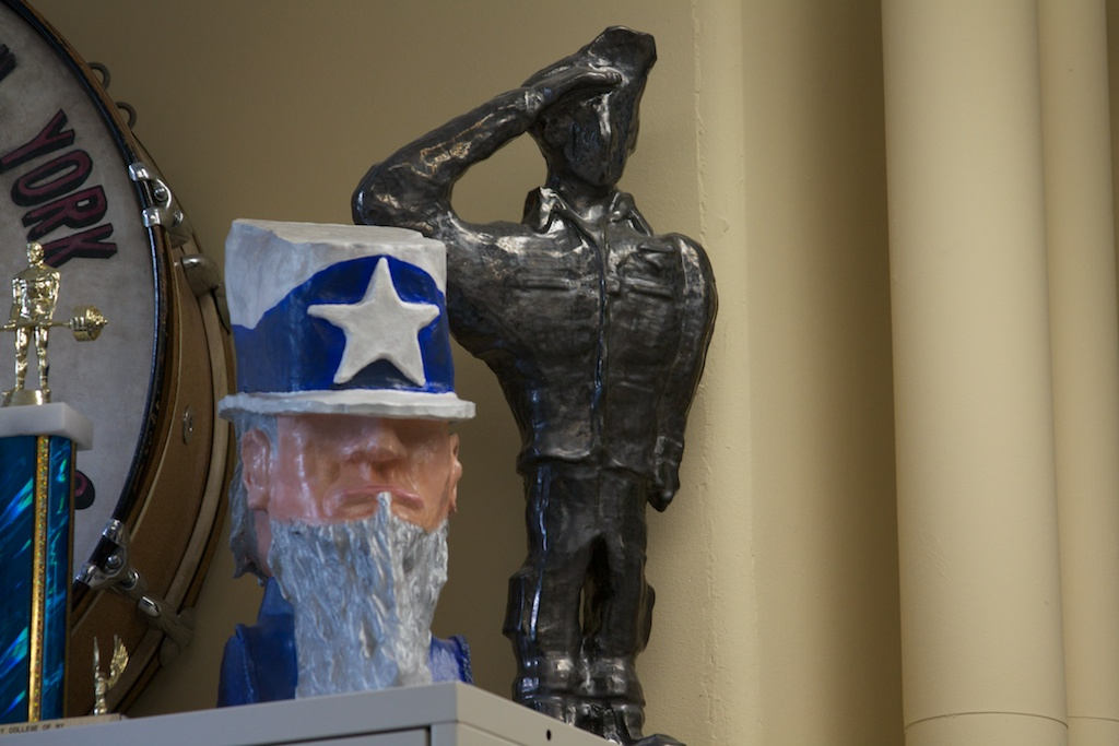 Various armed services memorabilia is scattered around the Veterans Affairs office.