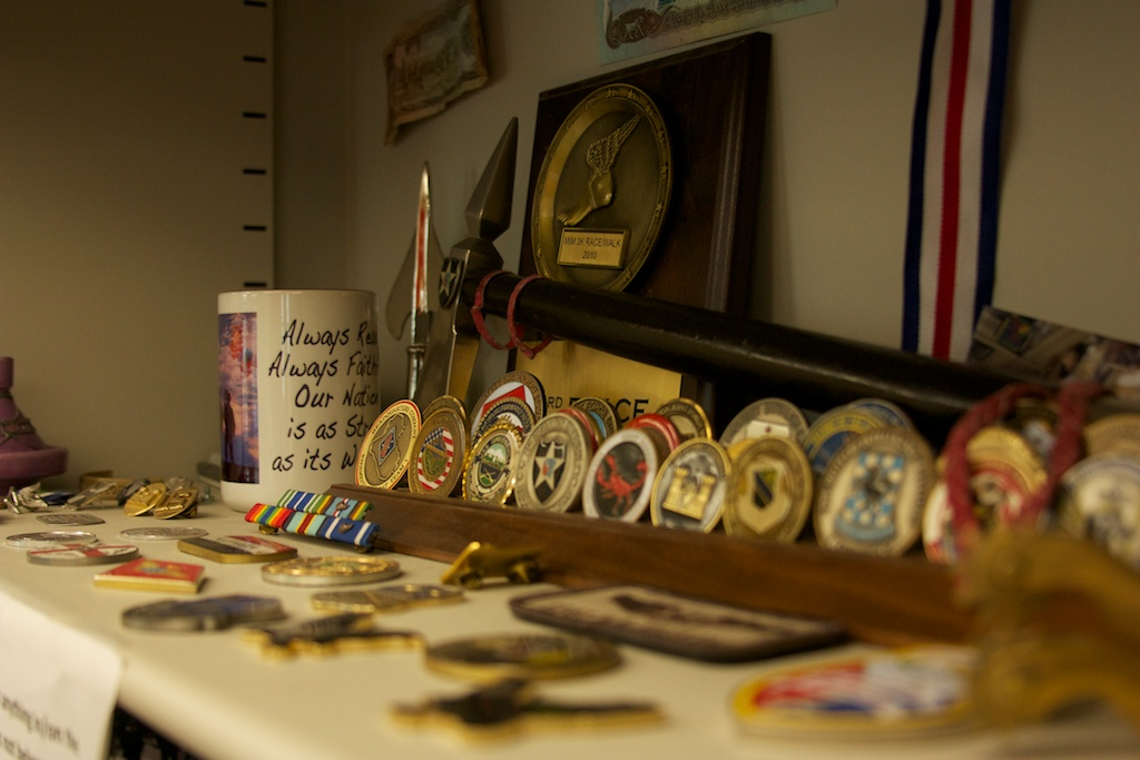 A shelf filled with medals of honor created by Hwang sits in the middle of the office.