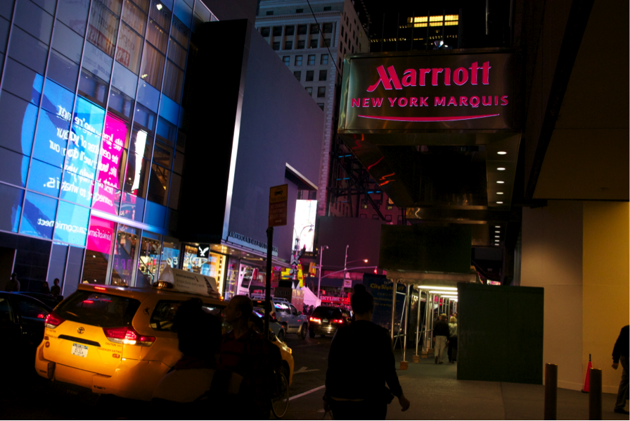 The New York Marriott Marquis, in Times Square, has almost 2,000 rooms and attracts tourists from around the world.
