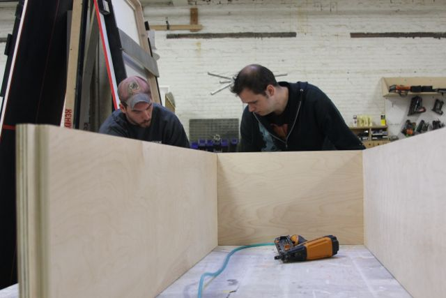 Workers from Greenpoint-based ReadySet:NYC construct a wooden display for a Calvin Klein storefront.   (Photo by Tobias Salinger)