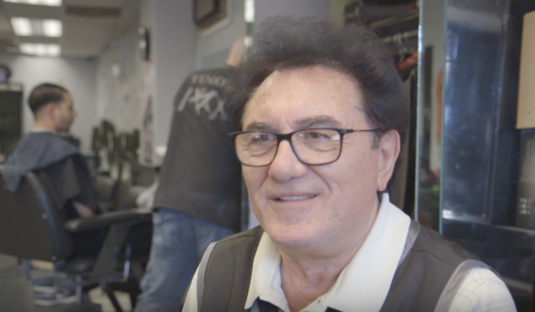 Tino Venzia, owner of Tino's Unisex Hairstyling in Far Rockaway, Queens. (Photo/Janae Hunter)