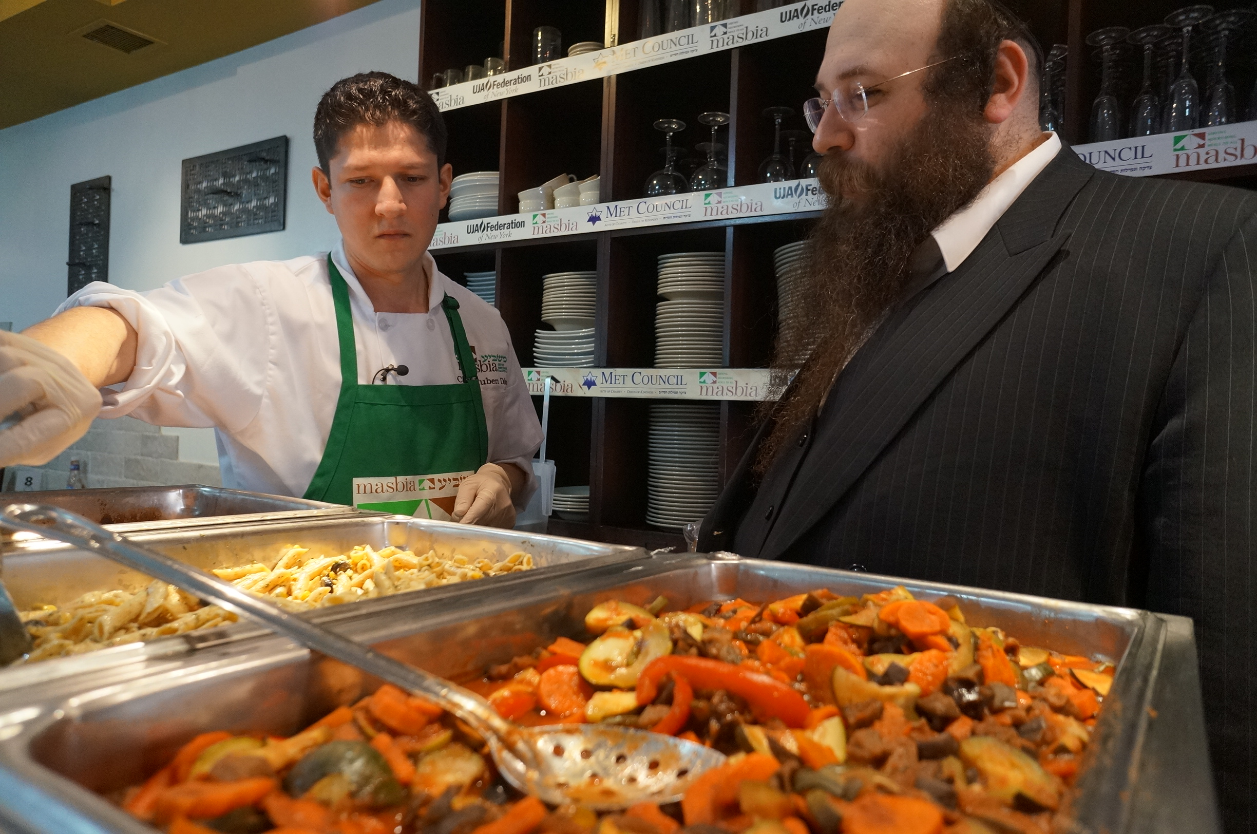 Chef Ruben Diaz (left) and Alexander Rapaport prepare hot meals at Masbia soup kitchen in Flatbush.