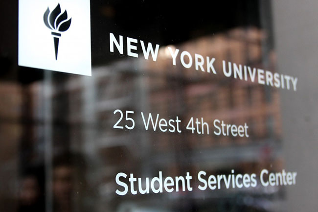 Students walk by a New York University building on March 9. (Credit: Rachael Levy)