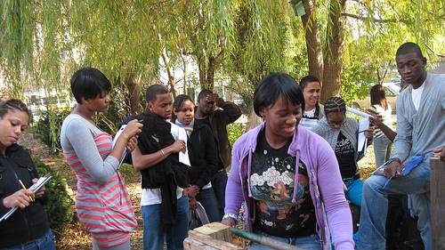 Students from  International High School learned about compost by doing at Brook Park. File photo by Urban Transformers