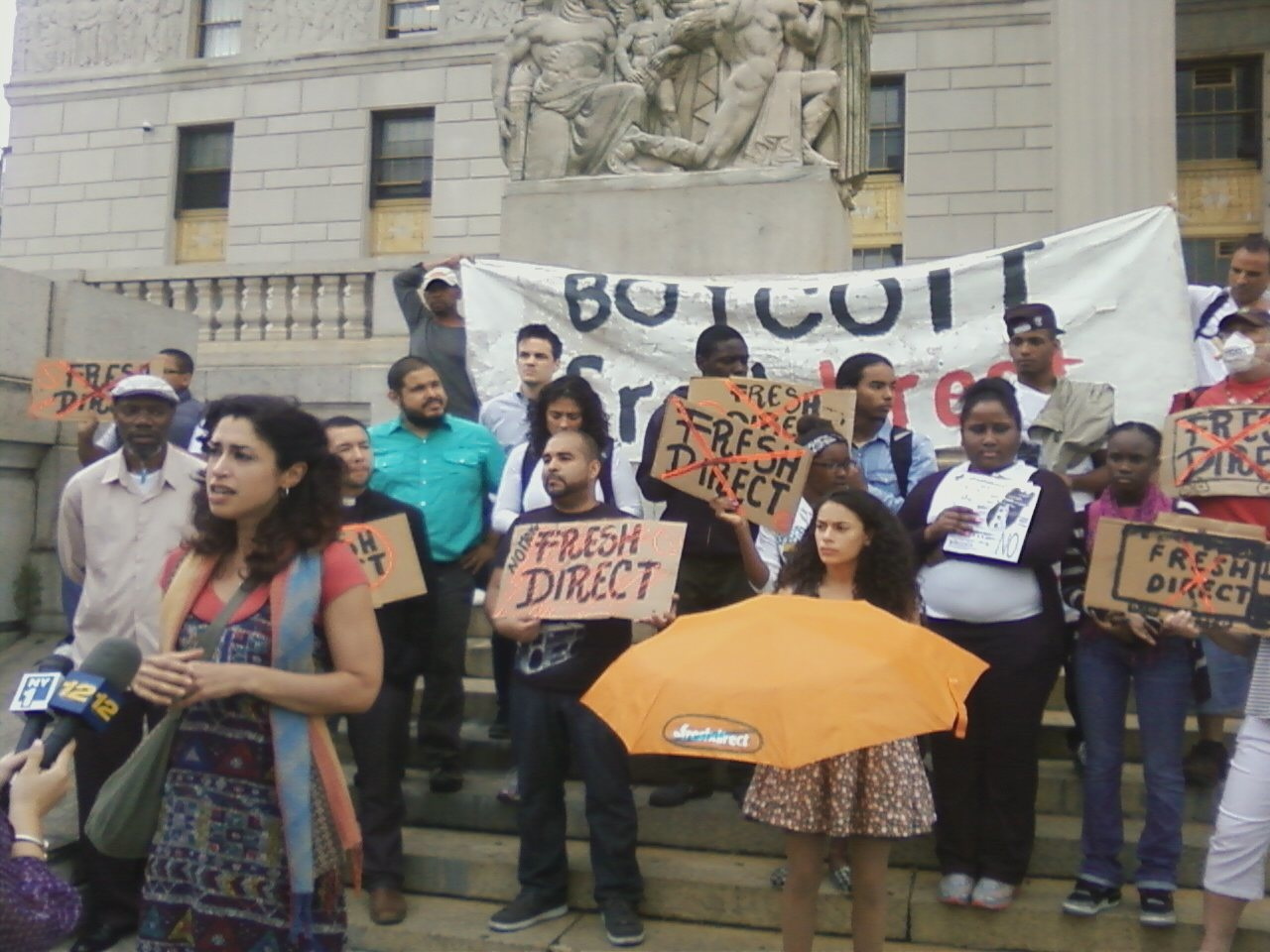 Mott Haven resident Libertad Guerra was one of several Mott Haven residents who applauded a lawsuit against FreshDirect in front of the Supreme Court Building on the Grand Concourse on June 13.