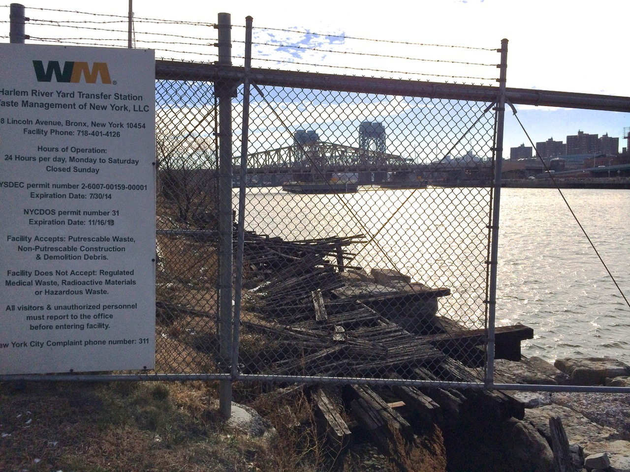 A section of shoreline is falling into the Harlem River.