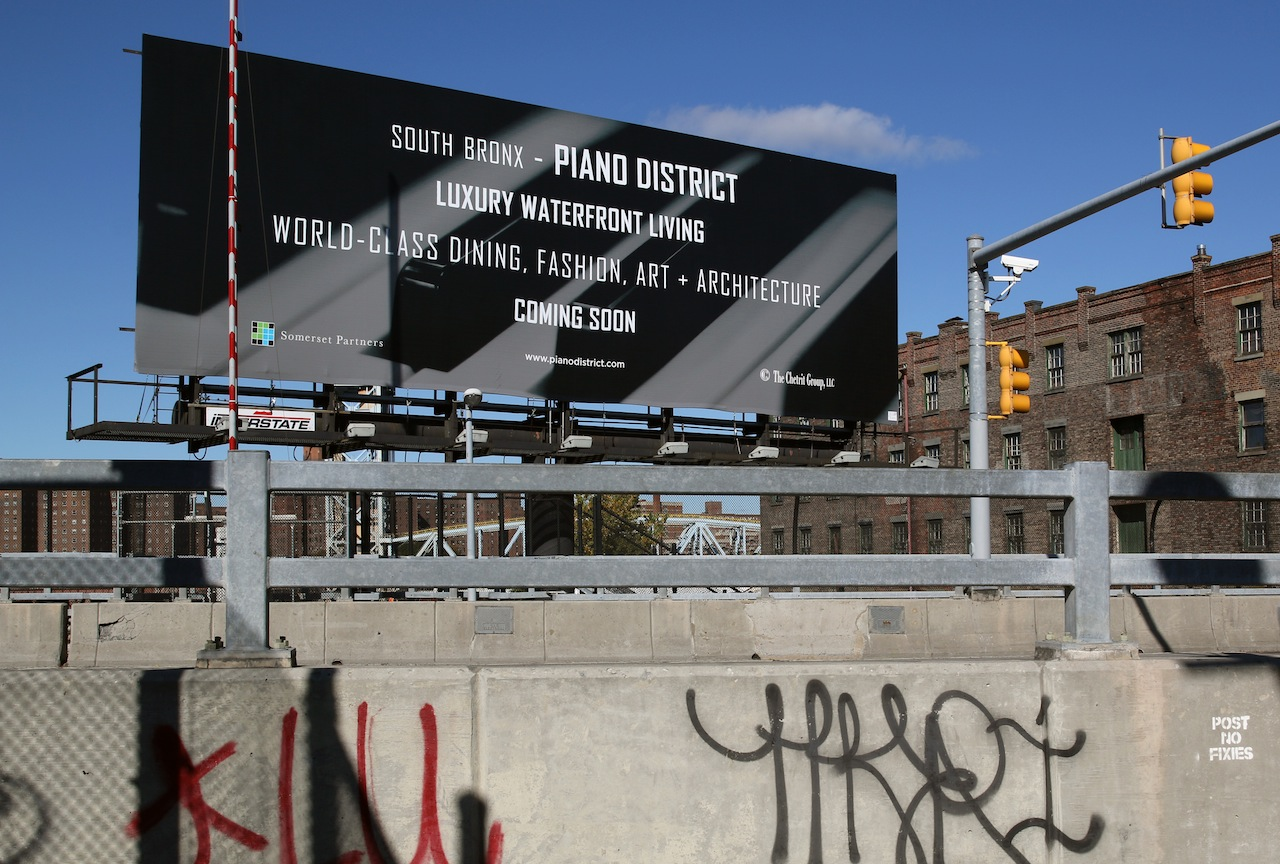 A new billboard in Port Morris dubs the neighborhood the Piano District.