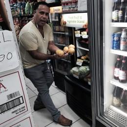 By Muri Assunção William Troncoso shows the fresh fruit fridge at Makey Deli.