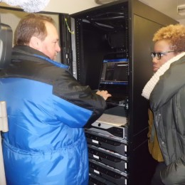 By Joe Hirsch. NYCHA's CEO Shola Olatoye and a security worker test the monitors at John Adams Houses.
