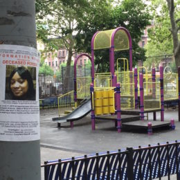 By Vianey Alderete Contreras. A wanted poster for the killer of Jessica White is hung in front of a playground at John Adams Houses in Morrisania.