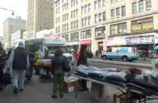 Vendors sell clothing in front of the 149/Third Ave. subway. Photo: Joe Hirsch