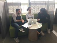 Elvis Garcia, Nohely Perez, and Mouminatou Barry discuss a class plan for intro to tech. Photo: Carmen Reinicke