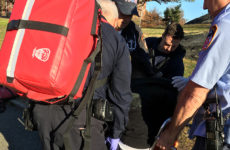 Medics from FDNY Ladder 55 tend to a man who overdosed in St. Mary's Park. Photo: Trevor Boyer