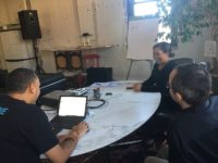 Amanda Septimo, (left) Phil Shearer, (middle) and Miguel Sanchez (right) plan for a pitch meeting in the MetaBronx office in Hunts Point. Photo: Carmen Reinicke