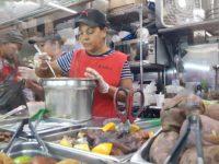 Lidia Gomez prepares soup at her bodega on Courtlandt Avenue. Photo: Paula Moura