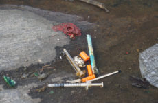 Discarded syringes on a Mott Haven street serve as a reminder of the epidemic at home. Photo: Kalah Siegel