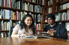 Bronx Junior Photo League members Chloe Rodriguez and Mitchell Dennis in the library of the Bronx Documentary Center. Photo by Pam Frederick.