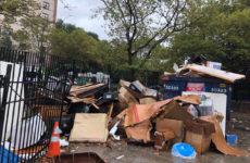 Trash piles up along 146th St. outside of Betances Houses. Photo by Rachel Rippetoe