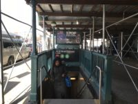 A straphanger ascends the stairs at the 149th Street-Grand Concourse subway station.