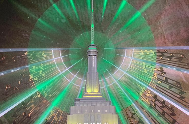 Rendering of the Empire State Building lit up in green and gold for Sesame Street's 50th anniversary