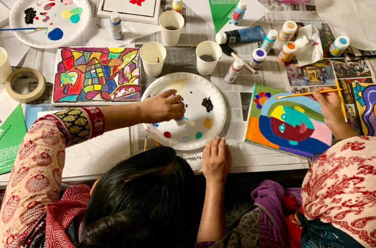 Women paint at Sapna NYC, a nonprofit serving Parkchester's South Asian immigrant community.