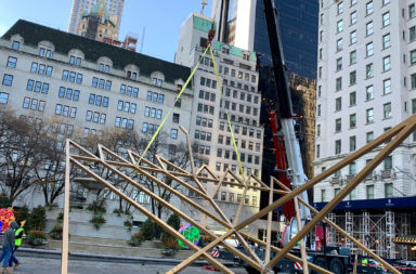 Crane lifts the world's largest menorah into place outside the Plaza Hotel in Manhattan.