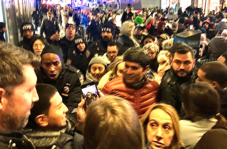 Police attempt to direct crowd in Rockefeller Center for tree lighting