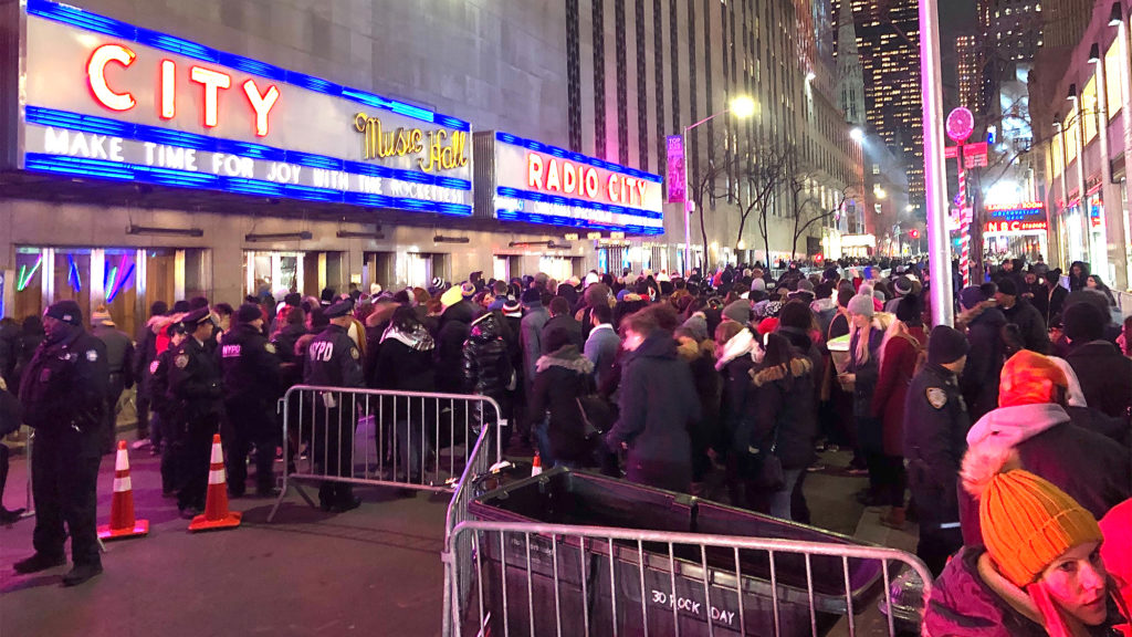 Crowd gathers on 50th Street near Fifth Avenue to try to get a glimpse of the Rockefeller Center tree.