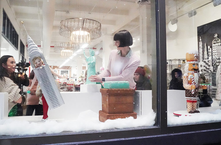 Ashley Holt, owner of Sugar Monster, places her chocolate Statue of Liberty into the window display at NY Cake, 118 West 22nd St.