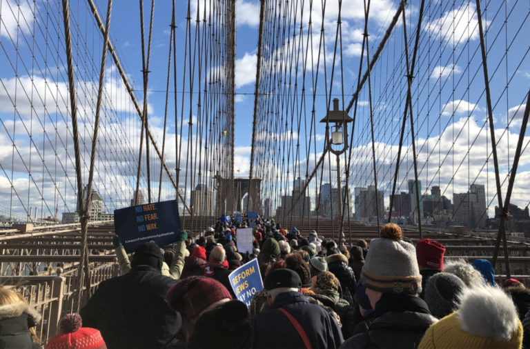 Thousands marched across the Brooklyn Bridge for a unified protest against anti-Semitic violence.