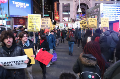 Protesters in Times Square demonstrate against US military action in the Mideast and Iraq.