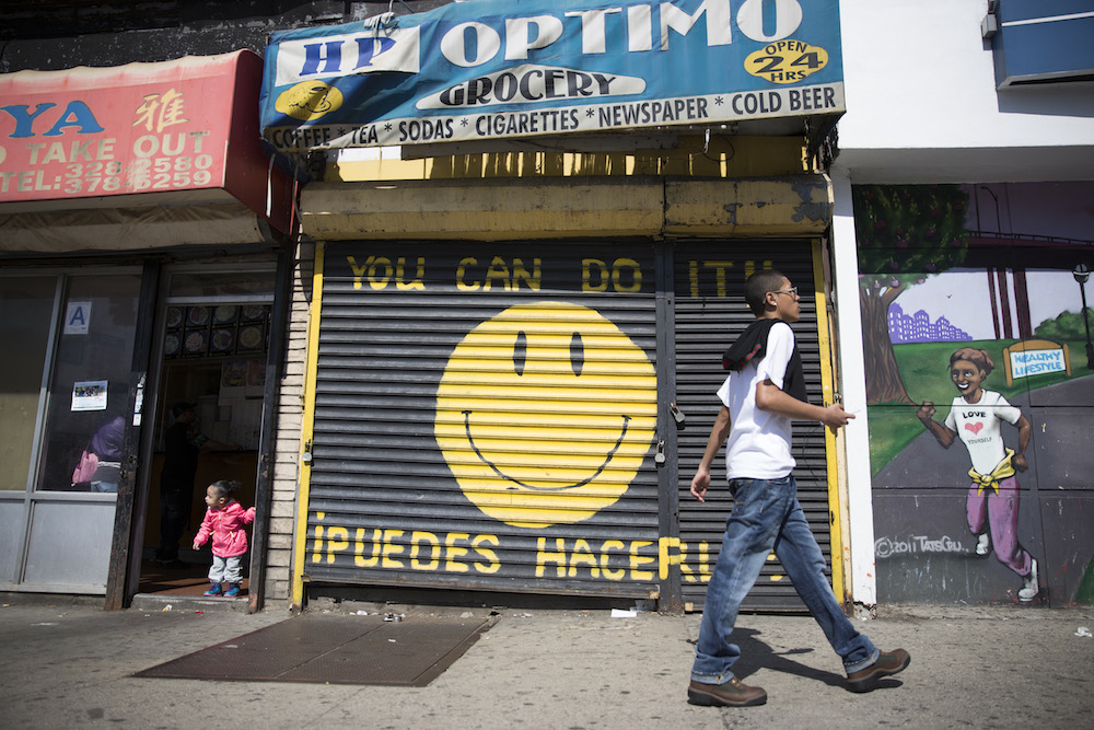 Pedestrians pass by a grocery storefront on Hunts Point Avenue in the Hunts Point neighborhood of the Bronx (photo by Jessica Bal).