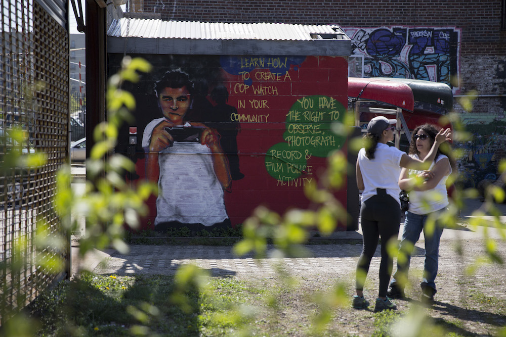 A mural in Hunts Point Riverside Park informs residents that they have the right to film cop behavior in the neighborhood (photo by Jessica Bal).